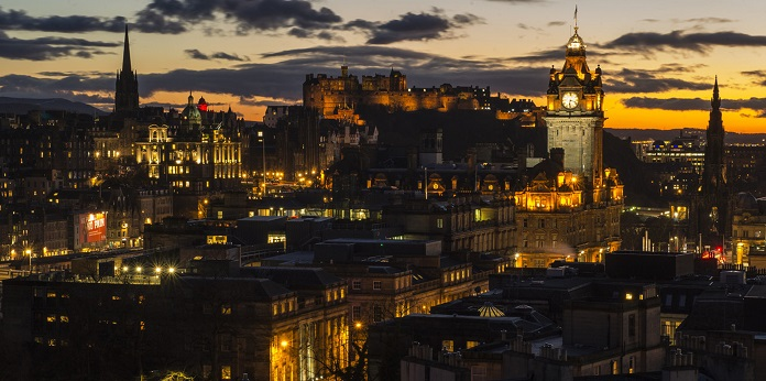 Edinburgh dusk city views. View form calton Hill with monument and Balmoral Hotel clock.