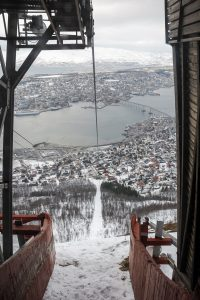 View from the top station of cable car above Tromso and view down on the city in winter time.